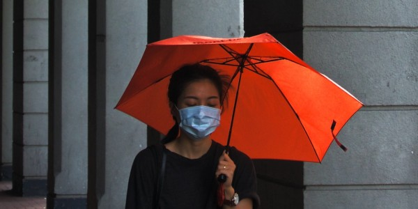 How are the coronavirus restrictions affecting domestic helpers in HK?