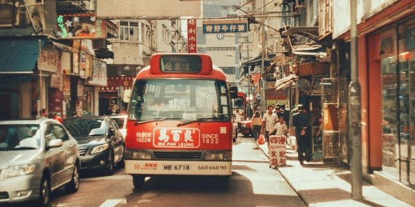 This image shows a minibus, one of the transportations in Hong Kong, driving down the streets.